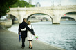 Caucasian couple hugging and walking near city river