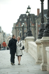 Caucasian couple walking on bridge