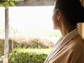 Close up of woman looking at view over Napa Valley, California at a luxury spa