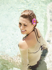 Overhead view of woman laughing sitting in pool at a luxury resort in Napa Valley, California