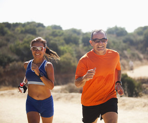 Couple running together in remote area