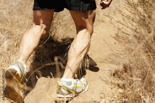 Hispanic man running on dirt road