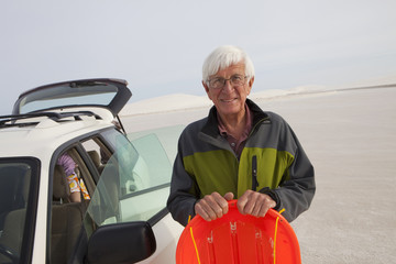 Senior Caucasian man in desert with sled
