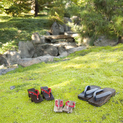 Japanese sandals on grass in garden