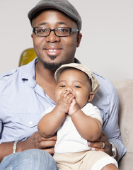 African American holding baby son in lap