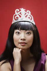 Elegant Asian woman in paper tiara