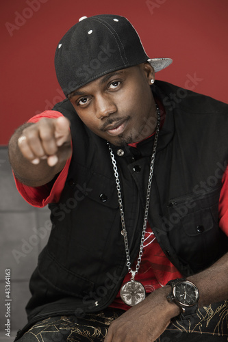 Black man in trendy clothes pointing