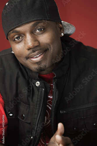 Smiling Black man in baseball cap