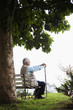 Senior man sitting on park bench
