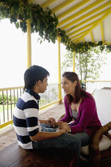 Mother and son talking on porch