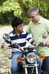 Father showing son motorcycle