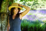 Fototapety Beautiful Woman under the shade of a tree