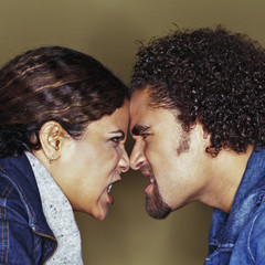 Grimacing couple having argument