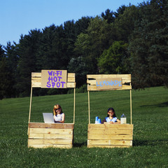 Girls with wi-fi enabled lemonade stand one without