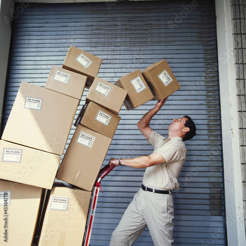 Boxes tipping on delivery man