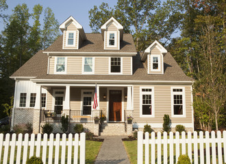 Front yard of house and picket fence