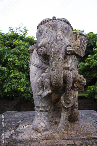 Stone statue of elephant carrying man