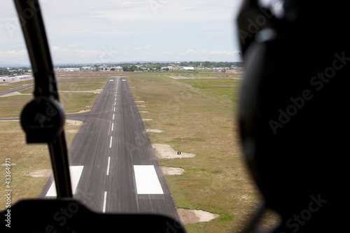 Cockpit view of airplane landing on airport runway