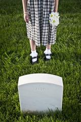 Caucasian girl visiting cemetery