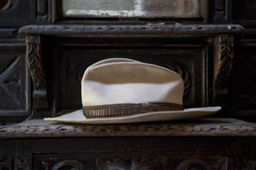 Close up of weathered fedora hat on shelf