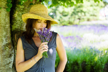 Woman smelling fresh lavender