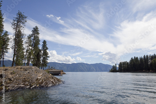 Blue sky over remote, tranquil lake