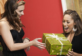Friends exchanging Christmas gift