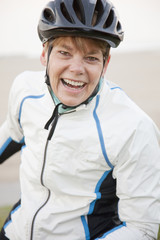 Smiling Caucasian woman in bike helmet