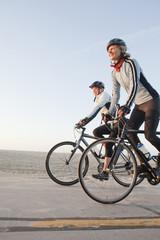 Caucasian women riding bicycles