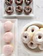 Frosted chocolate and strawberry donuts and donut holes, top view