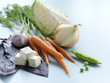 Natural cooking ingredients, including baby carrots, cabbage, snap peas, and garlic