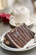Extravagant chocolate cake served with whipped cream topped coffee