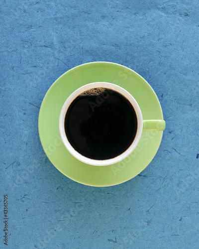 Full coffee cup and saucer, top view