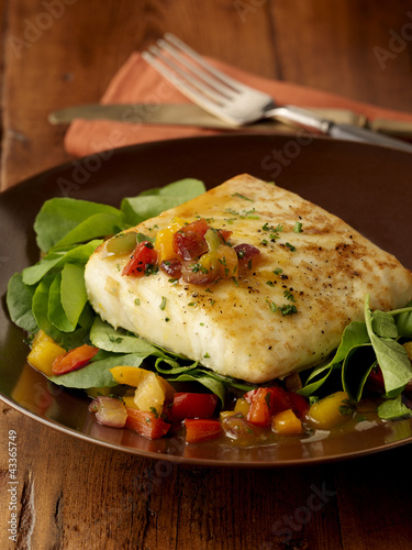 Baked halibut served with green salad