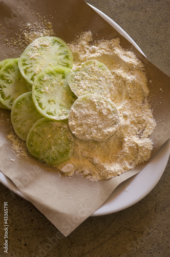 Breaded green tomatoes prepared for frying