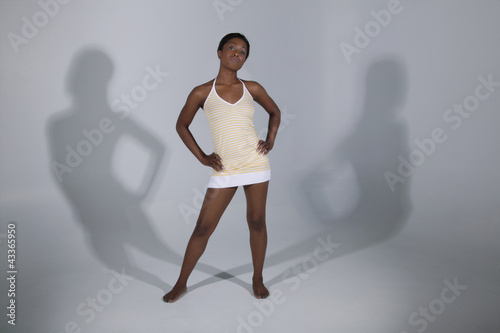 Mixed race woman standing with hands on hips