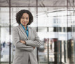 Mixed race busineswoman standing in office