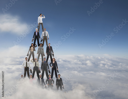 Business people making a human pyramid