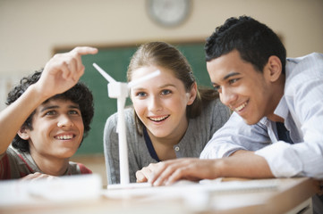 Teenage students studying wind power