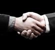 handshake over black background