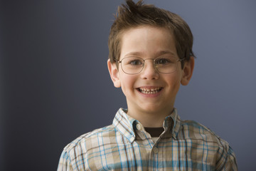Smiling Caucasian boy wearing eyeglasses