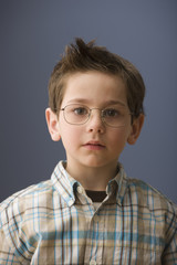 Serious Caucasian boy wearing eyeglasses