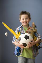 Caucasian boy holding toys