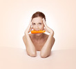 Beautiful woman with carrot in her mouth