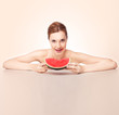 Attractive woman with watermelon piece