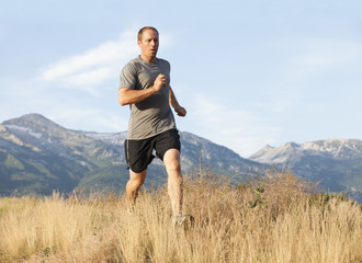 Caucasian man running in remote area