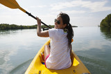 Hispanic woman paddling kayak