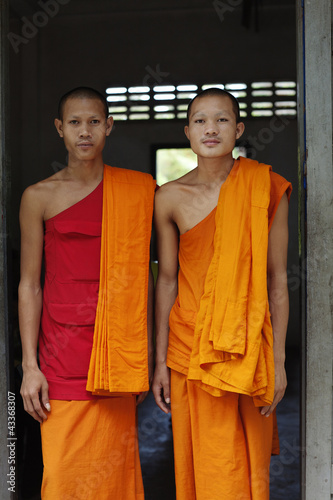 Cambodian monks standing in doorway