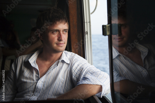 Caucasian man riding in boat