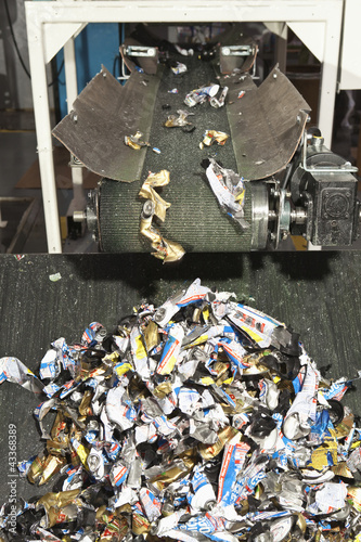Shredded recycling coming off conveyor